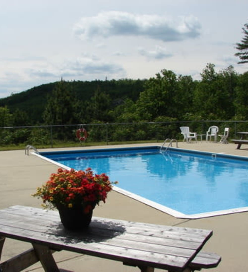Sparkling swimming pool at Branch River Apartments in Raymond, New Hampshire