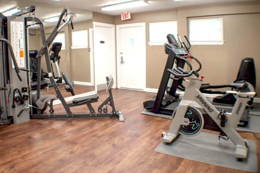 Fitness center with individual workout-stations at Laurel Pines Apartments in Richmond, Virginia