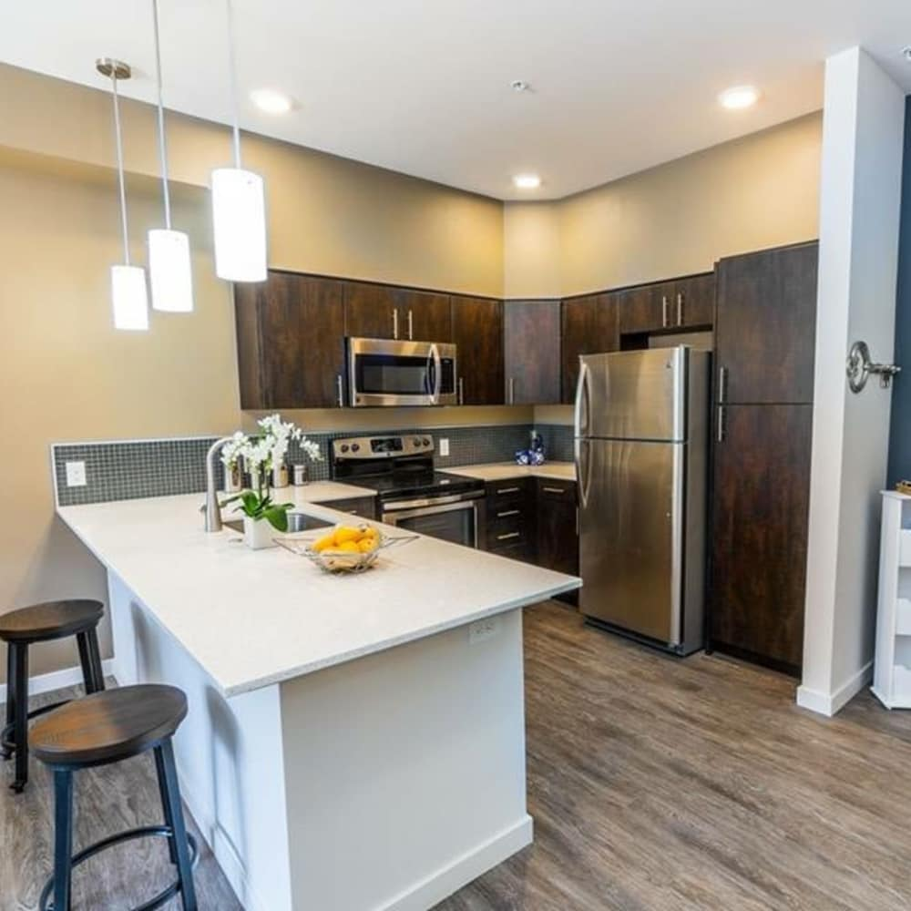 Beautiful kitchen with breakfast bar at South Block Apartments in Salem, Oregon