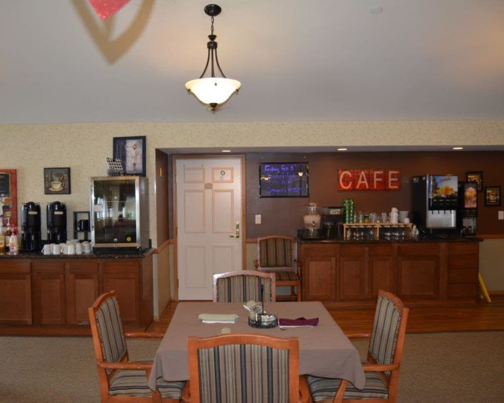 Self-serve coffee and beverage station in dining room at Courtyard Estates at Hawthorne Crossing in Bondurant, Iowa.