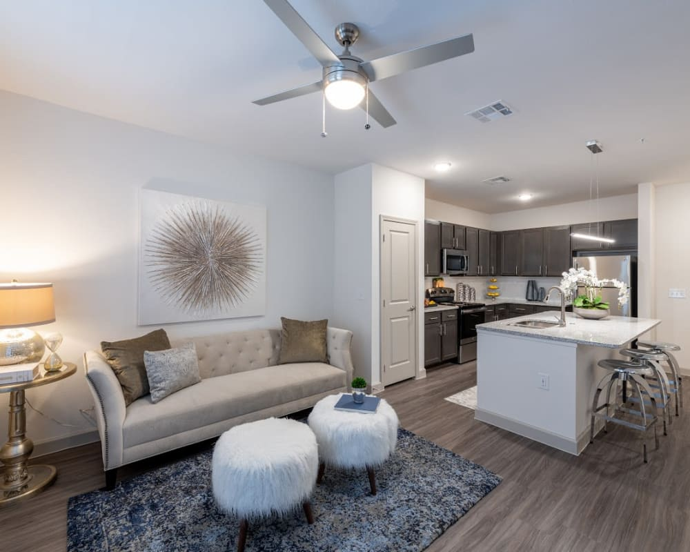 Upscale apartment with hardwood floors and a kitchen island at The Luxe at Cedar Hill in Cedar Hill, Texas
