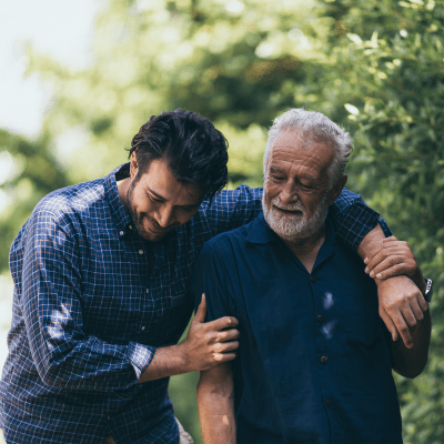 Resident and son walk together at Milestone Retirement Communities