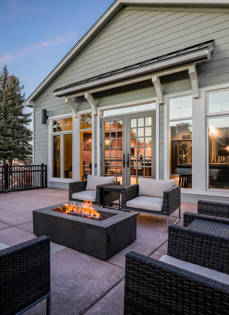 Outdoor sitting area with a fire pit at Marquis Castle Pines in Castle Pines, Colorado
