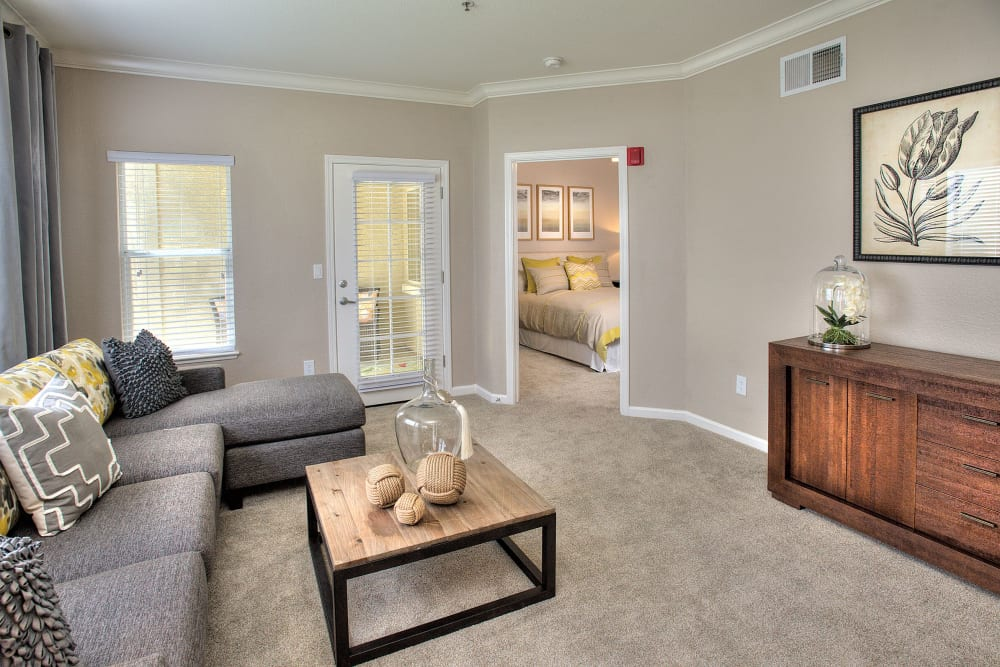 Model living room with plush carpeting at Iron Point at Prairie Oaks in Folsom, California