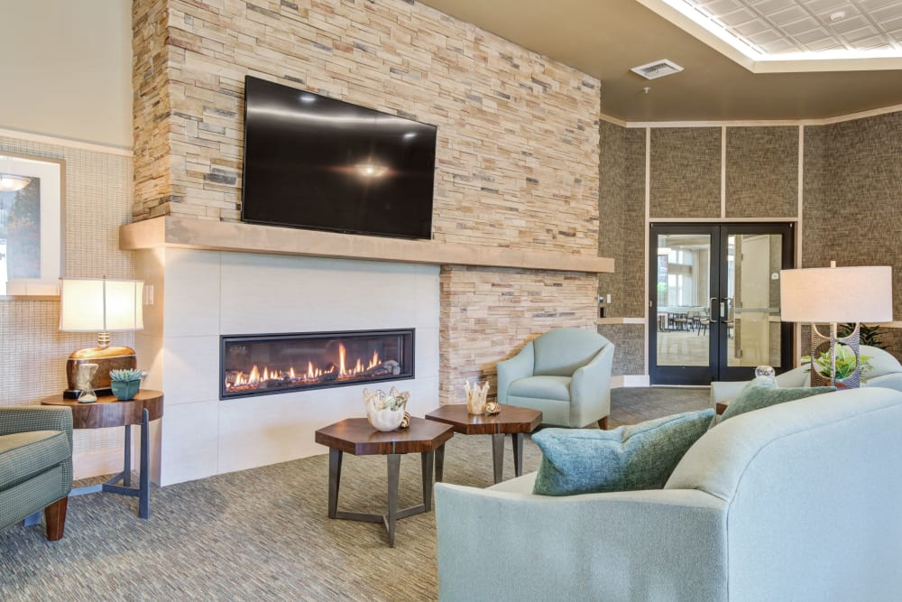 Lounge with fireplace at Merrill Gardens at Renton Centre in Renton, Washington.