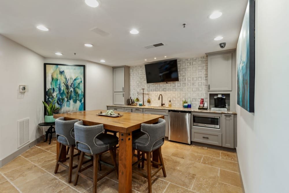 Modern kitchen and dining area with tile flooring at 45Eighty Dunwoody Apartment Homes in Dunwoody, Georgia