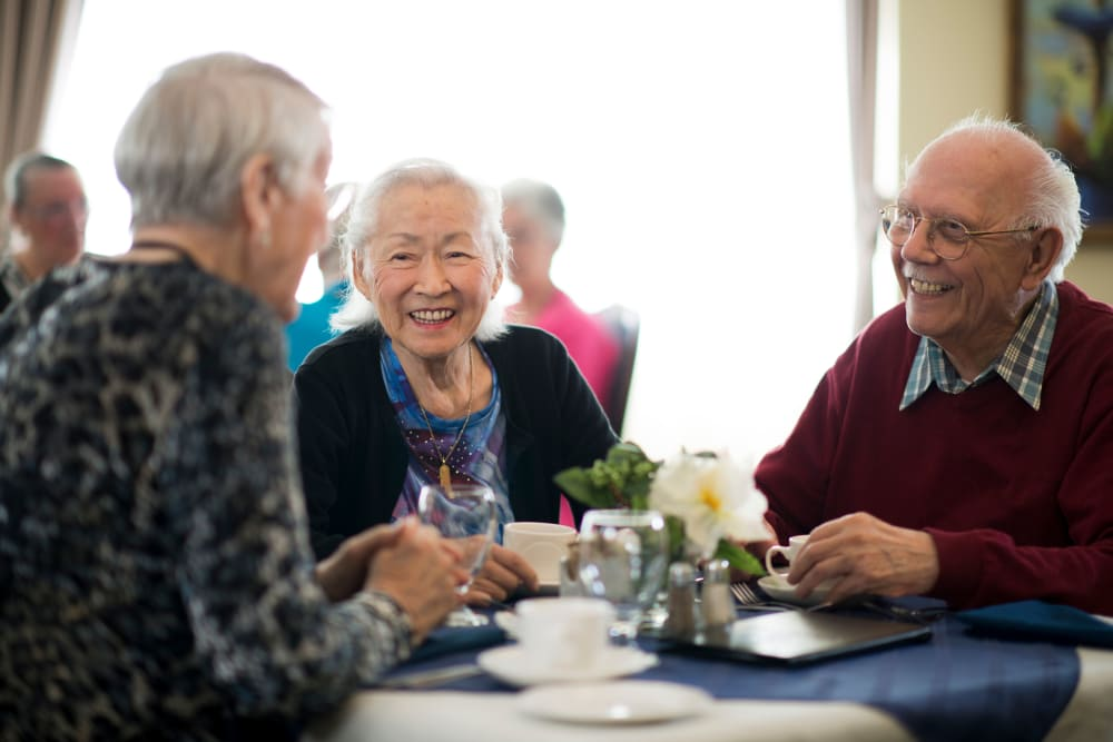 Senior residents of Arbor Oaks Senior Living communities gathering for lunch