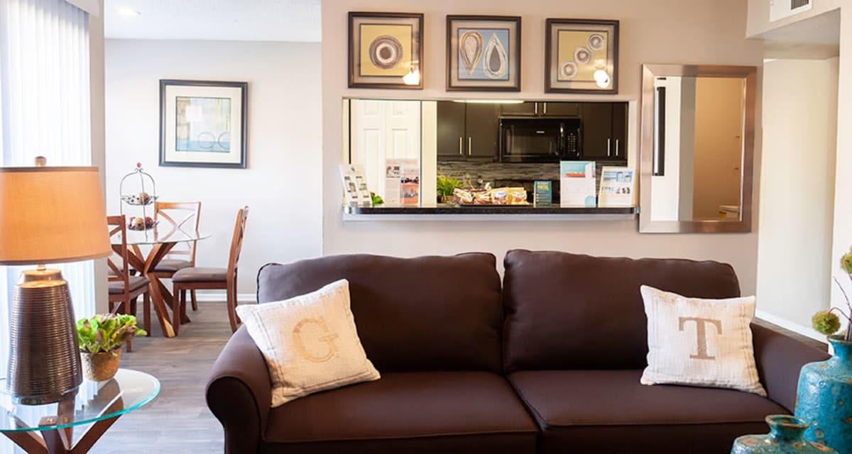 Spacious living room at Greentree Apartments in Carrollton, Texas