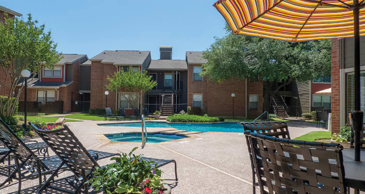 Lounge pool seating available at apartments in Carrollton, Texas