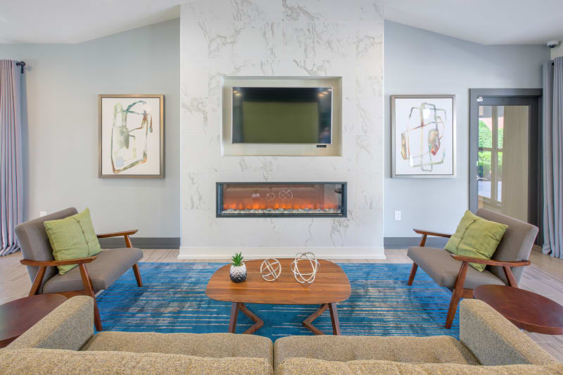 Lounge with TV in clubhouse at Presley Oaks in Charlotte, North Carolina