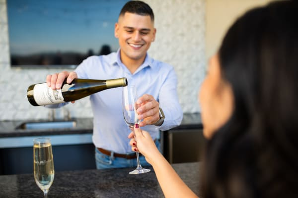 Man pouring a glass of wine near The Palms on Scottsdale in Tempe, Arizona