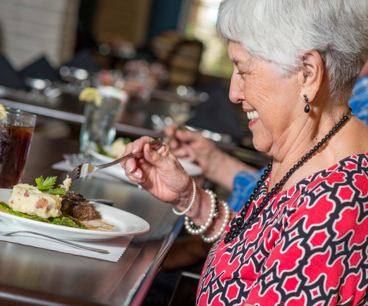 A lady having a meal at Watermere at Flower Mound in Flower Mound, Texas