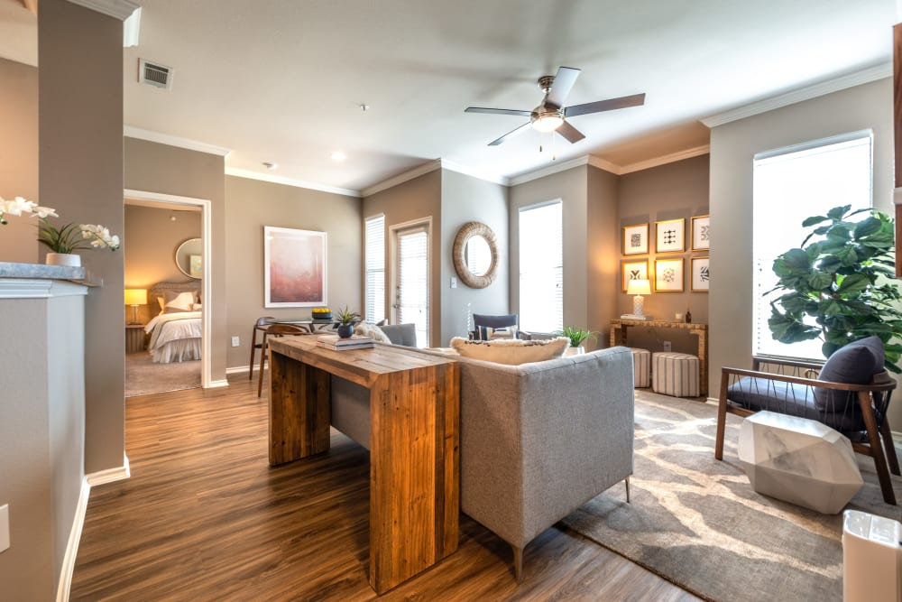 Well-furnished living area in a model home at Olympus Team Ranch in Benbrook, Texas