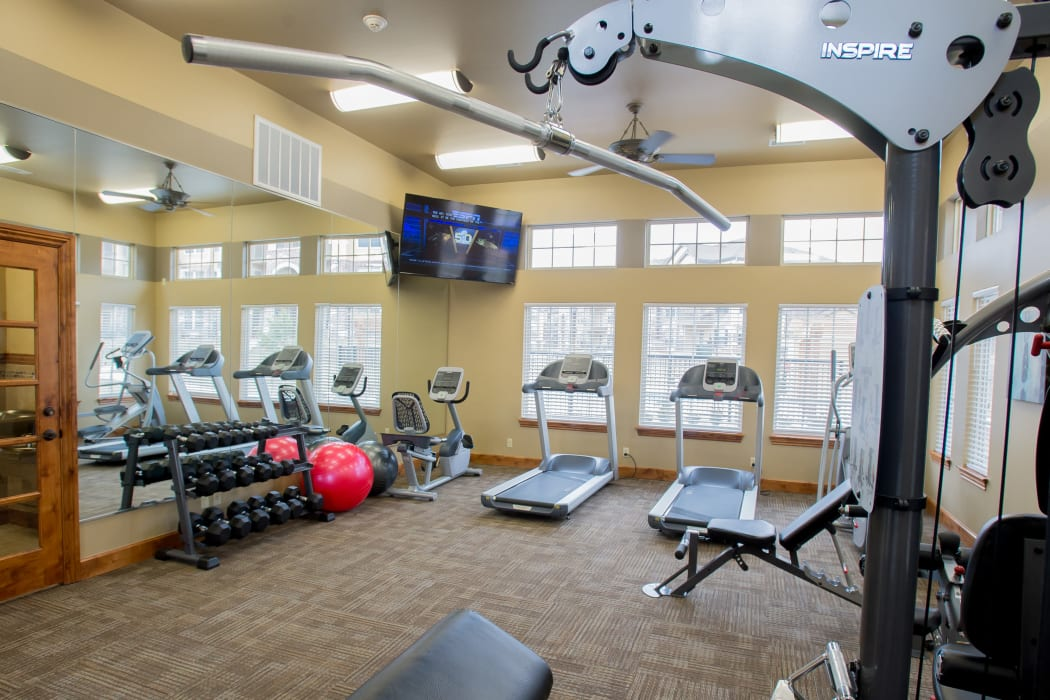 Fully equipped fitness center at Portofino Apartments in Wichita, Kansas