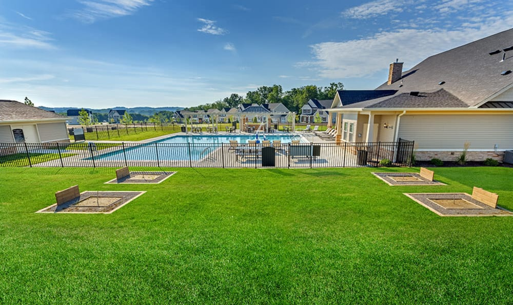 A swimming pool that is great for entertaining at Rochester Village Apartments at Park Place in Cranberry Township, PA