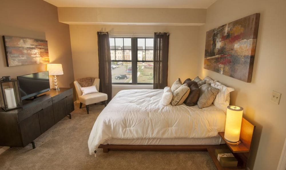 Modern bedroom at Rochester Village Apartments at Park Place in Cranberry Township, Pennsylvania