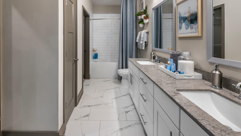 A bathroom with dual sinks at Olympus Emerald Coast in Destin, Florida