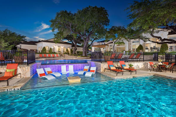 Swimming pool with lounge area at Villas of Vista Del Norte in San Antonio, Texas