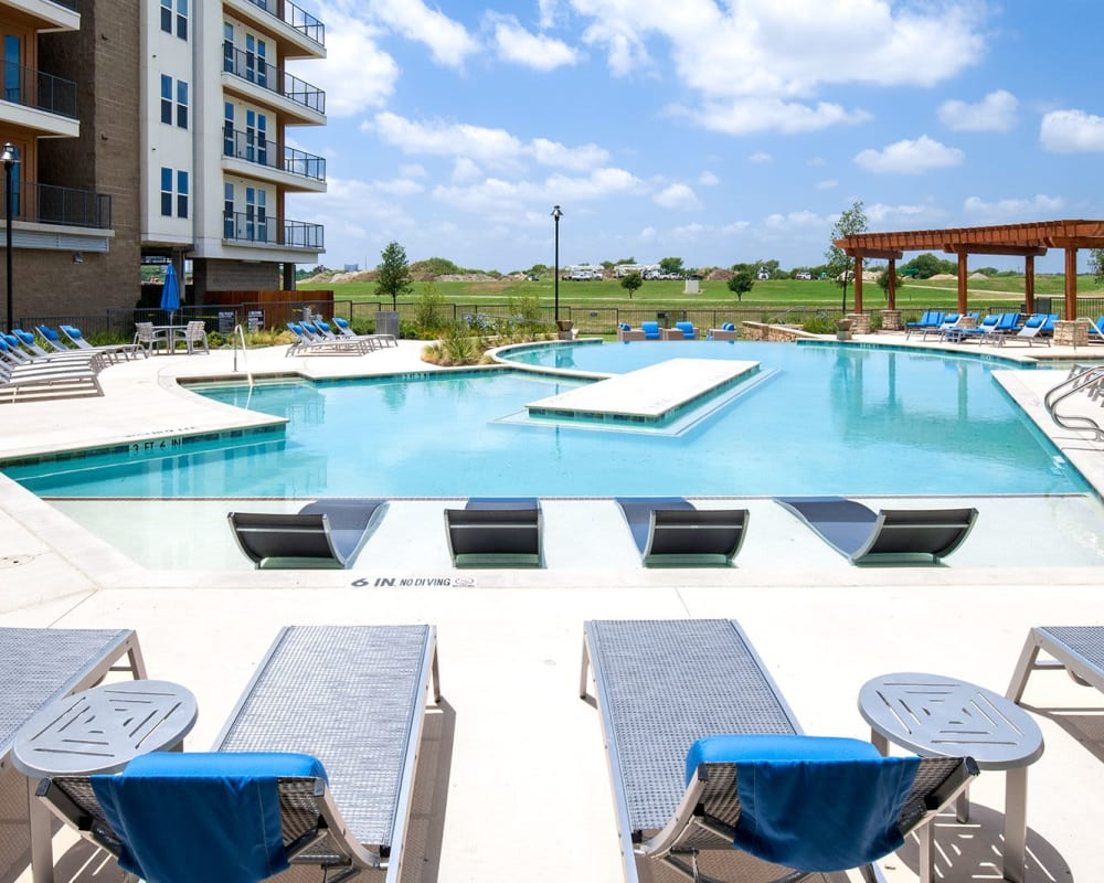 Resort-style swimming pool and sundeck at a luxury community by Electra America in Lake Park, Florida