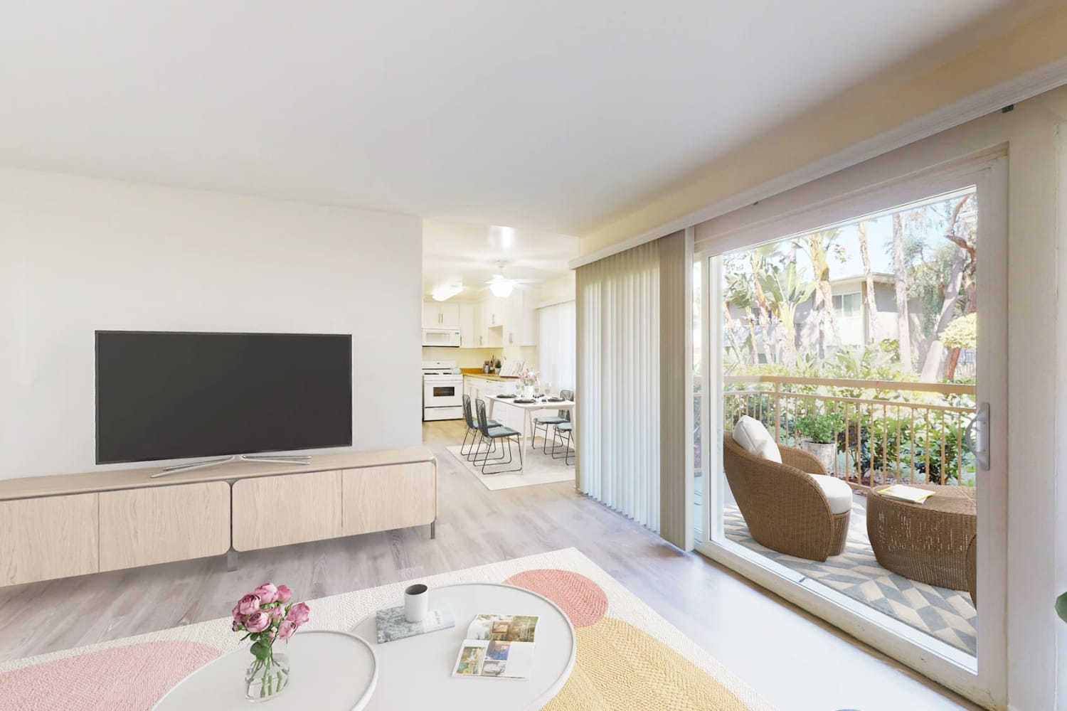 Two bedroom home's living space with floor-to-ceiling windows at West Park Village in Los Angeles, California
