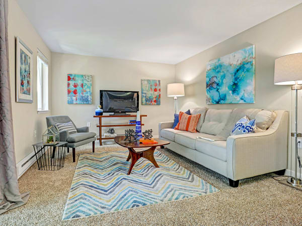 A fully furnished living room at Cascade Ridge in Silverdale, Washington