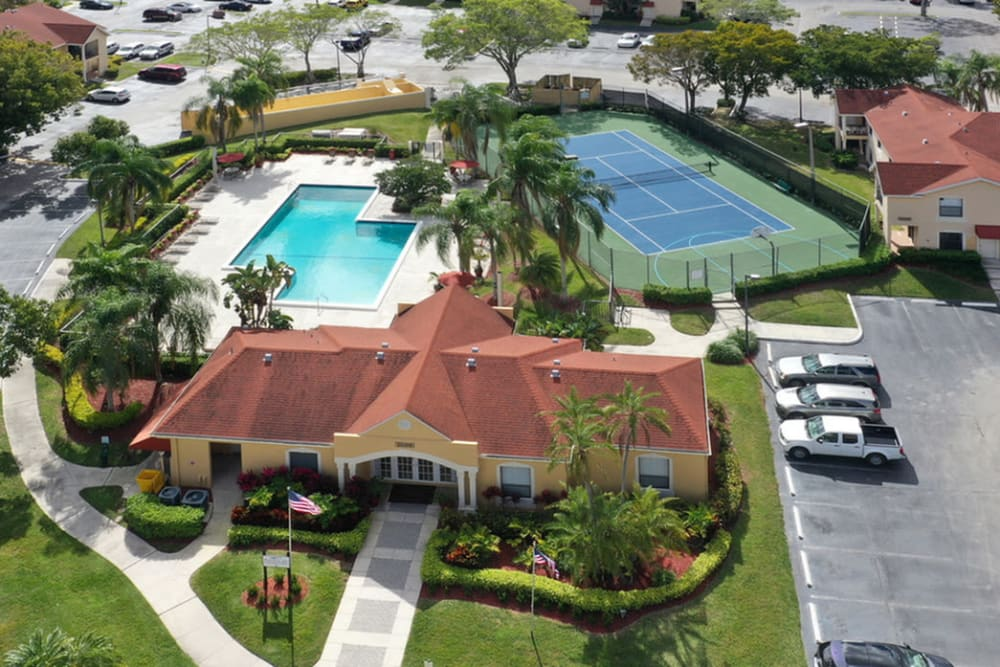 Aerial view of pool and clubhouse at Savannah Place Apartments & Townhomes in Boca Raton, Florida