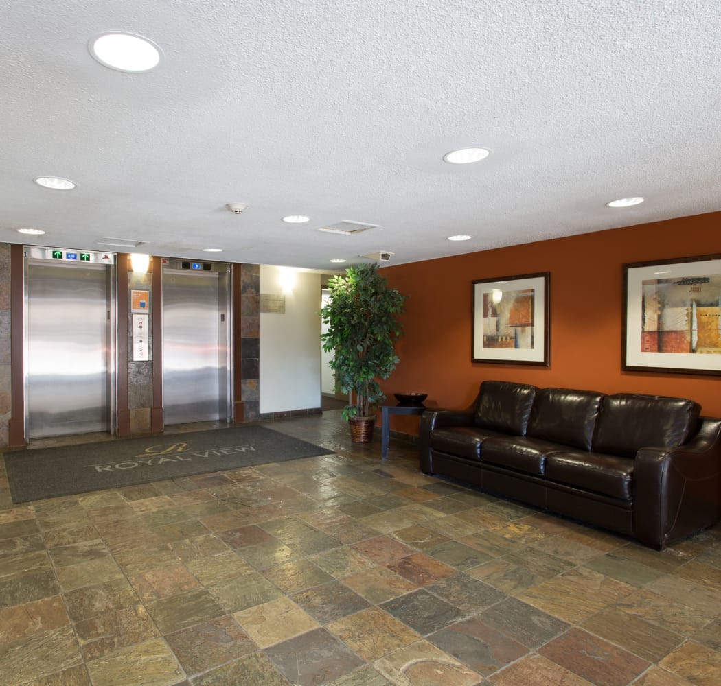 Lobby with elevators at Royal View Apartments in Calgary