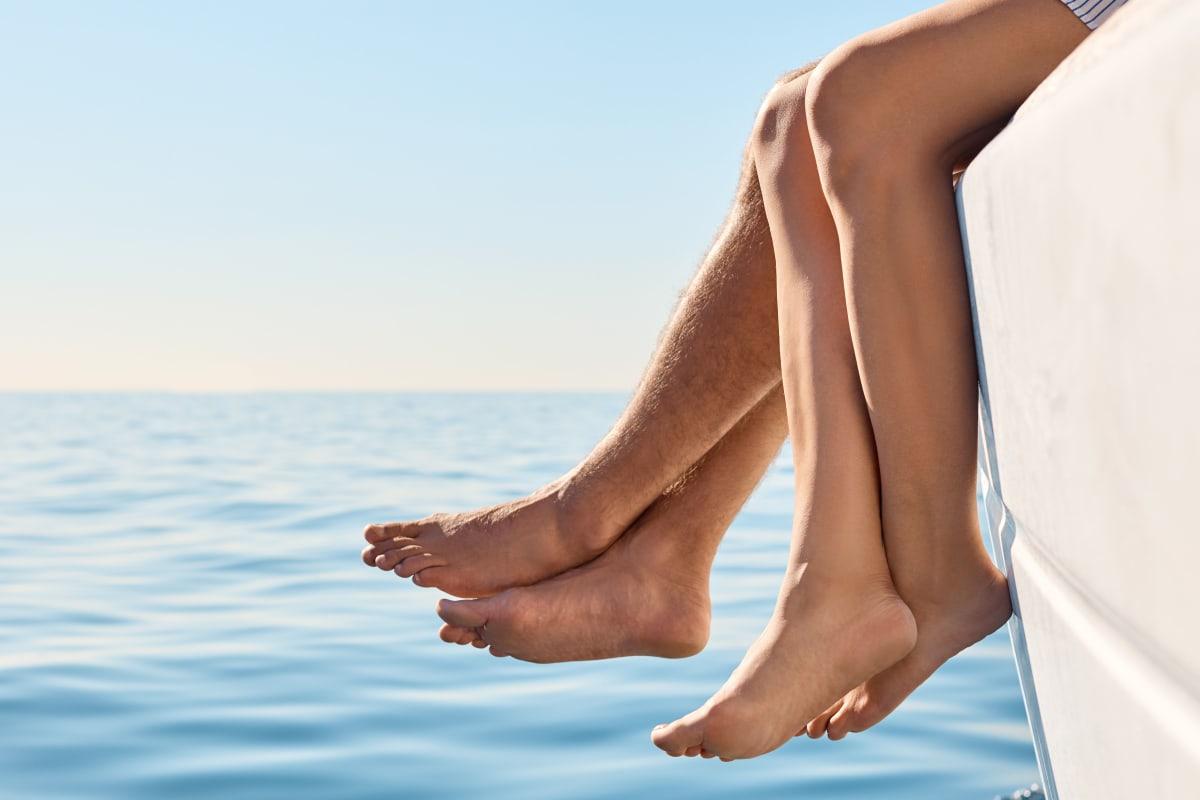 Happy feet hanging off the bow of boat at Marina Harbor in Marina del Rey, California