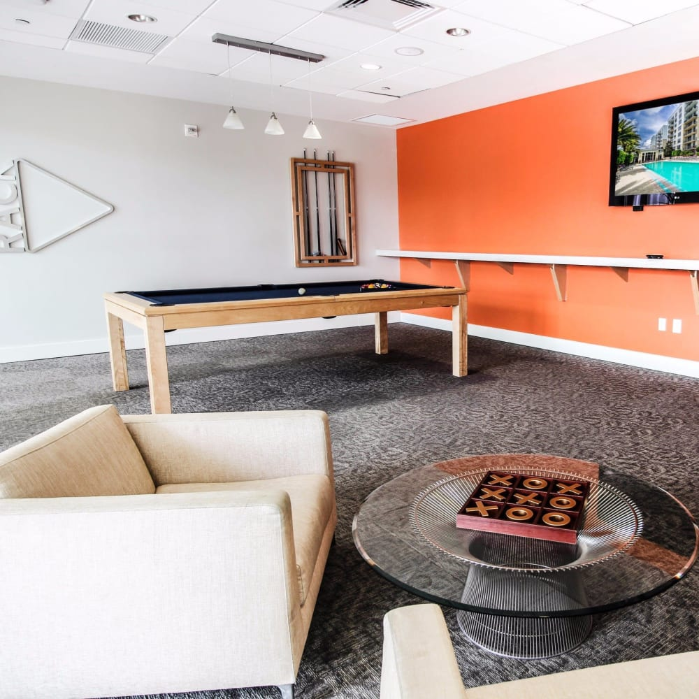 Game room with a billiards table and a flat-screen TV at Midtown 24 in Plantation, Florida