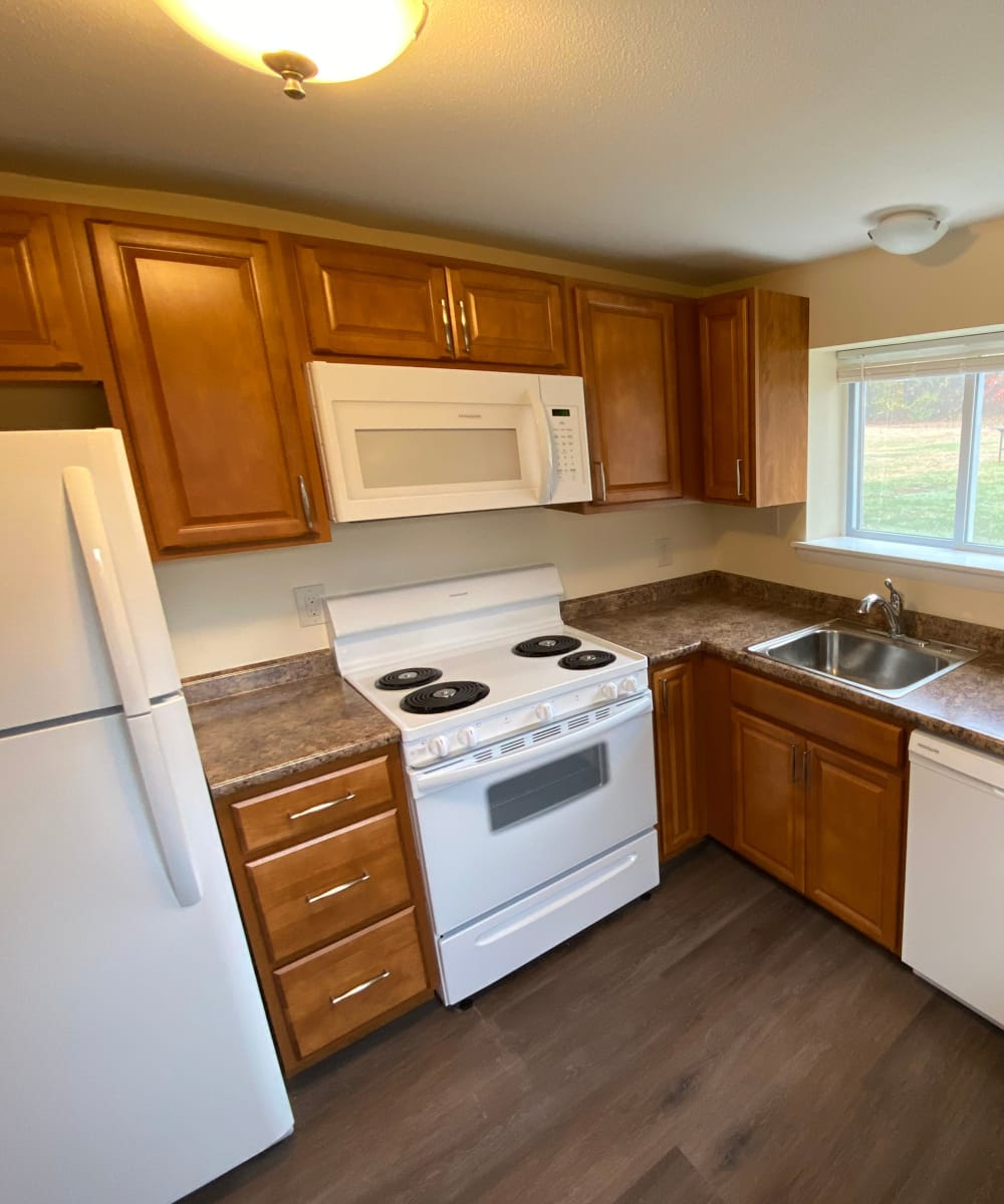 Bright kitchen at The Woodlands Apartments in Londonderry, New Hampshire