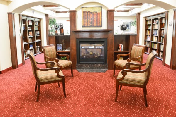 Fireside seating in the library at Ashwood Meadows Gracious Retirement Living in Johns Creek, Georgia