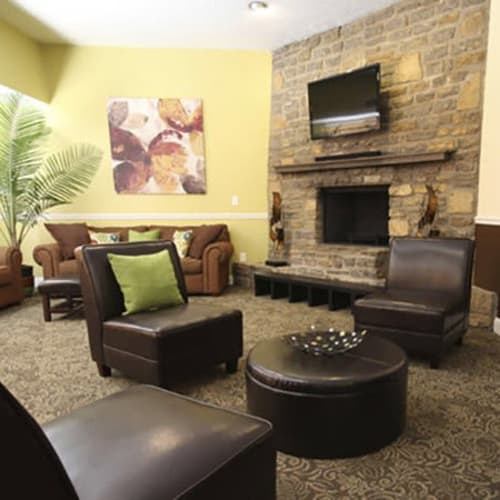 Resident clubhouse with large fireplace at Lakeside Landing Apartments in Lakeside Park, Kentucky