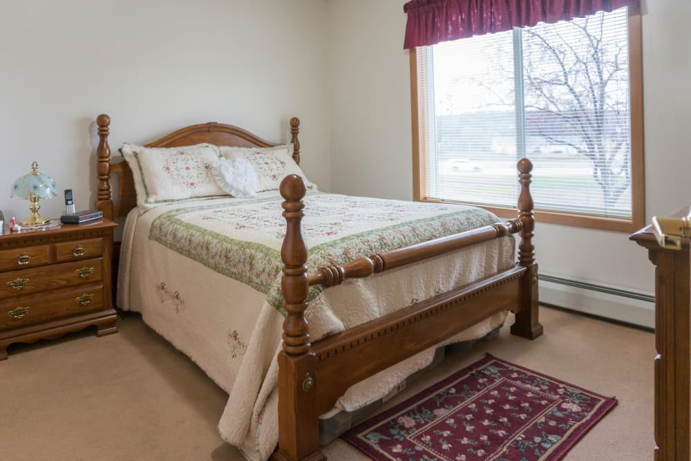 Spacious private resident bedroom at Meadow Lakes Senior Living in Rochester, Minnesota.