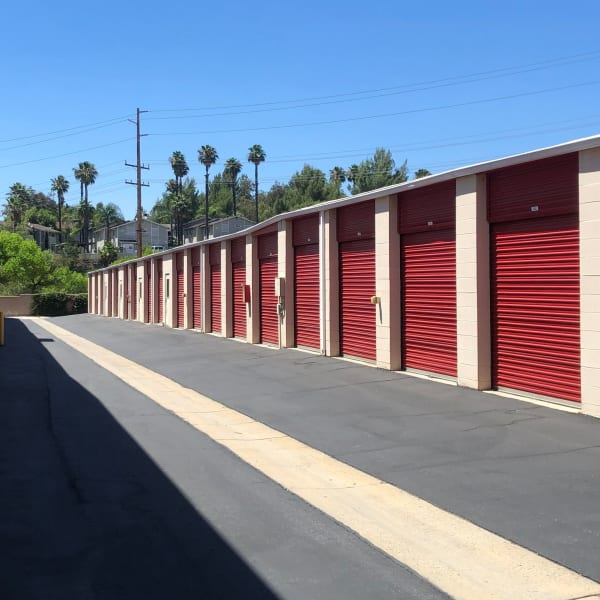 Outdoor storage units with red doors at StorQuest Self Storage in Temecula, California
