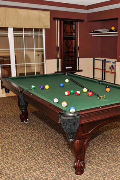 Play billiards with friends at Racquet Club Apartments in Rochester, NY