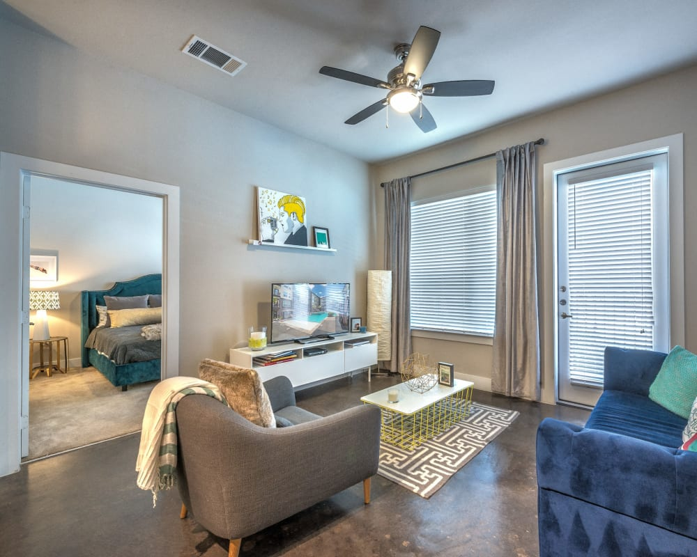 Comfortably decorated living space in a model home at Olympus at Ross in Dallas, Texas