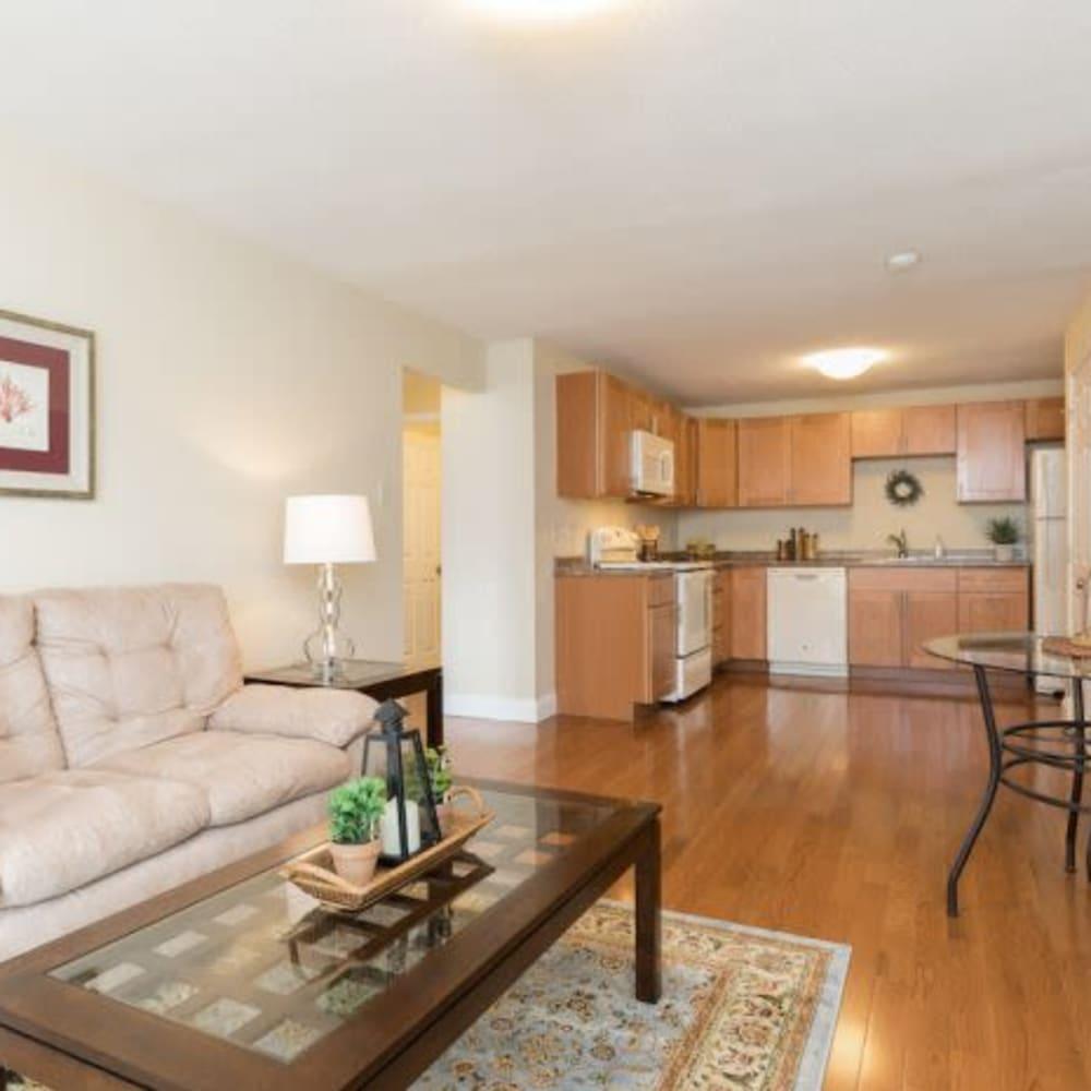 Bright, spacious living room at Olde Hampton Village Apartments in Hampton, New Hampshire