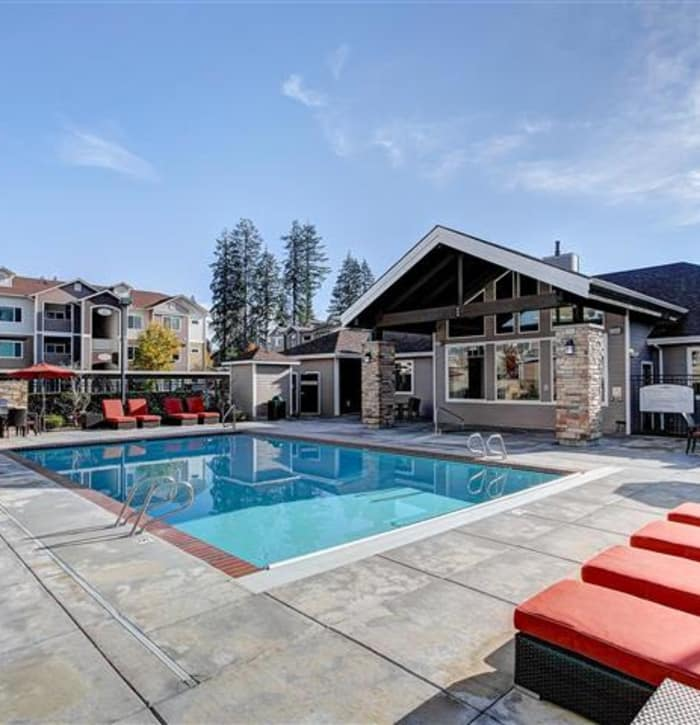 Beautiful swimming pool area at Woodland Apartments in Olympia, WA