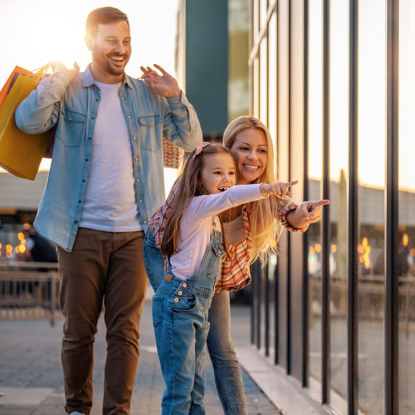Resident family shopping with their daughter near Olympus Falcon Landing in Katy, Texas