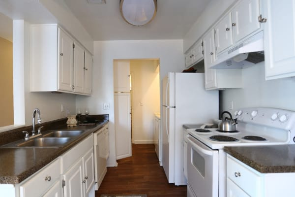 Kitchen in apartment at Cornerstone Apartments in Huntsville, Texas