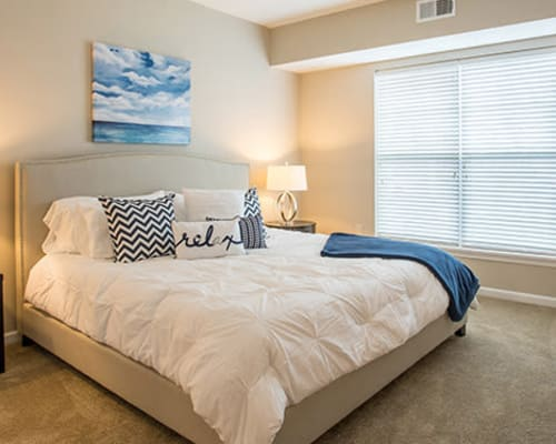 Bright master bedroom at The Landings at Meadowood in Baldwinsville, New York