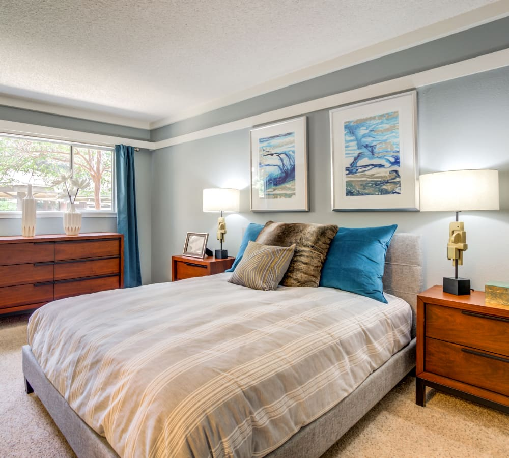 Plush carpeting and draped windows in a model home's bedroom at Sofi Fremont in Fremont, California