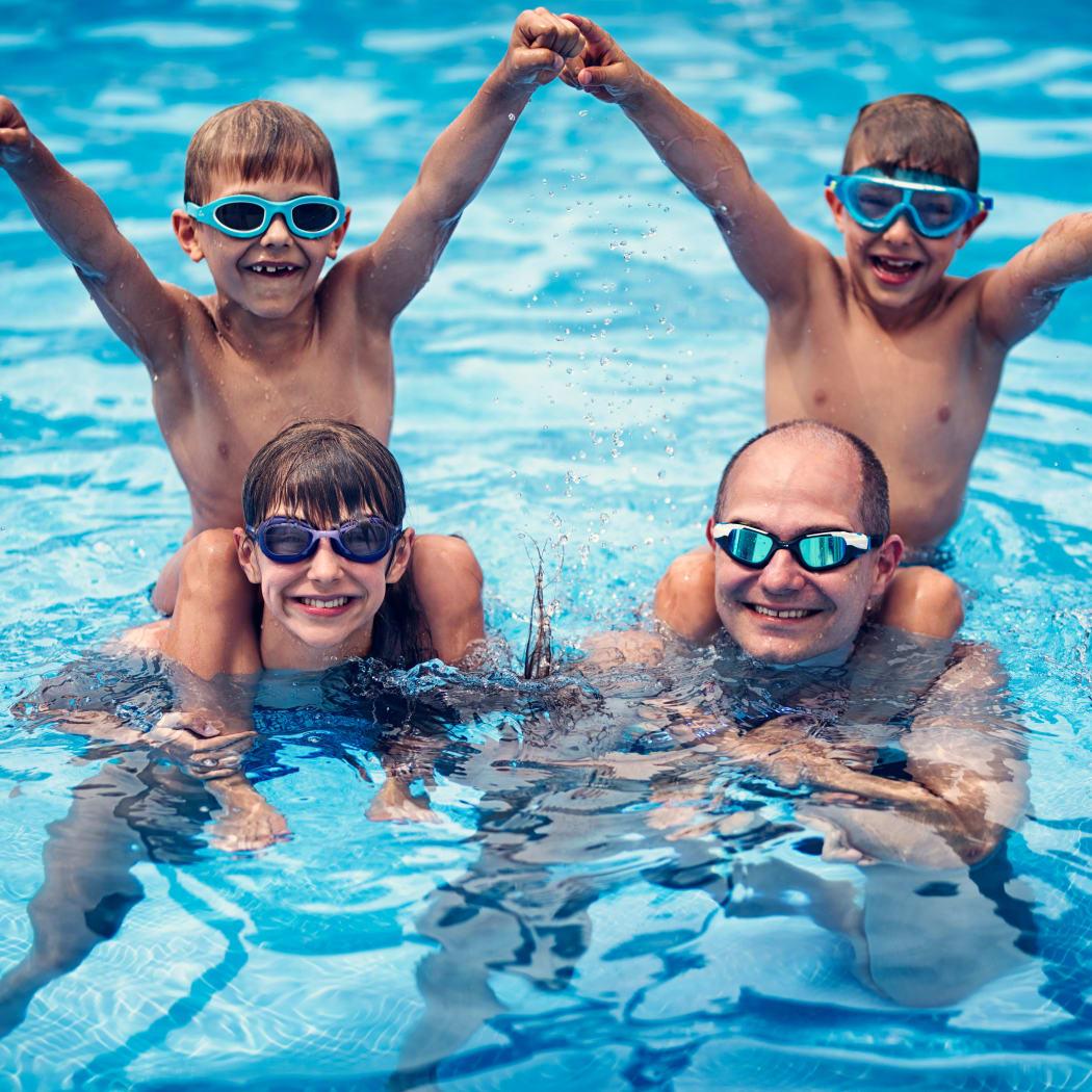 Family enjoying the refreshing swimming pool at Avilla Buffalo Run in Commerce City, Colorado