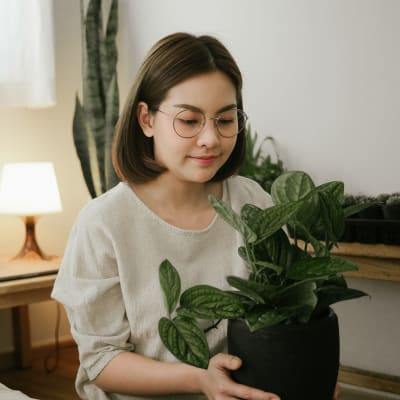 Resident holding a plant at Marquis SoCo in Austin, Texas