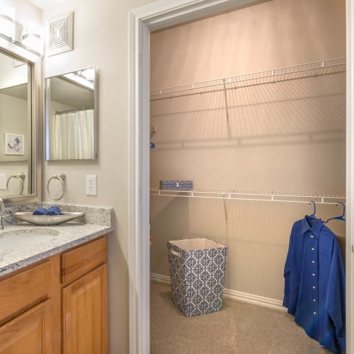 Walk-in closet in a model home's bathroom at Olympus Stone Glen in Keller, Texas