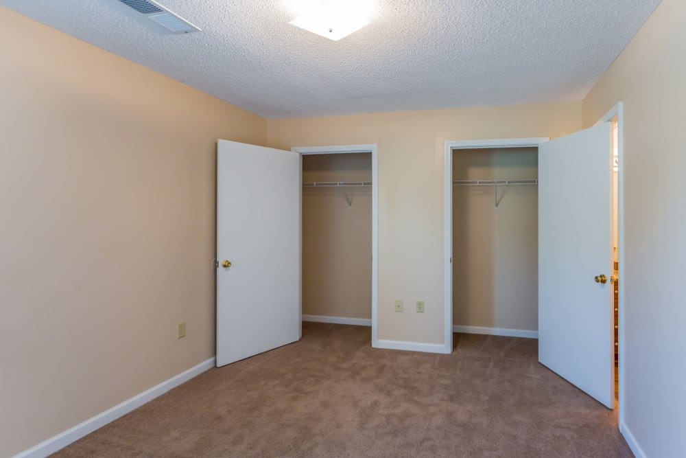 A bedroom with two closets at Park Ridge Apartments in Jackson, Tennessee