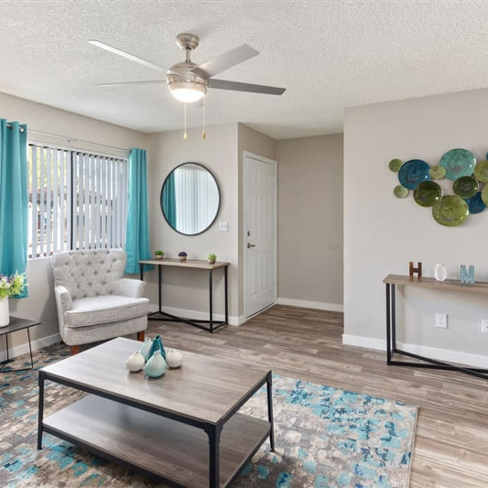 A living room with a large window at 1408 Casitas at Palm Valley in Avondale, Arizona