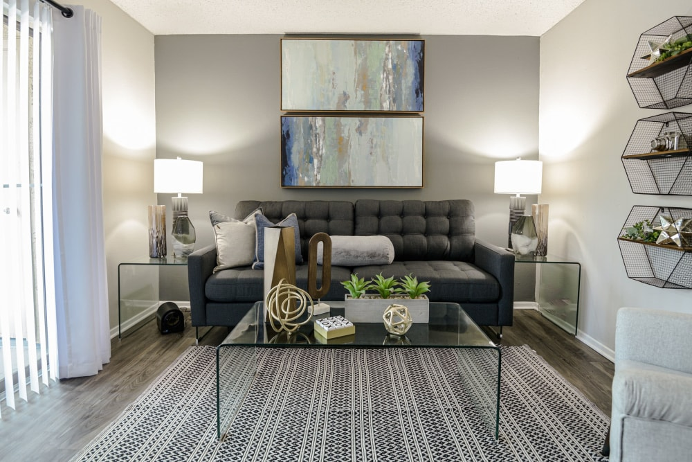 Living room with modern decor at The Regent in Dallas, Texas