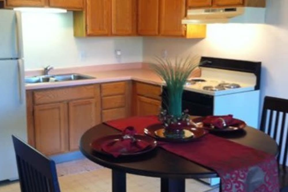 Cozy apartment kitchen at Avalon Assisted Living Community in Fitchburg, Wisconsin