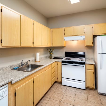 Kitchen with ample appliances at Natomas Park Apartments in Sacramento, California